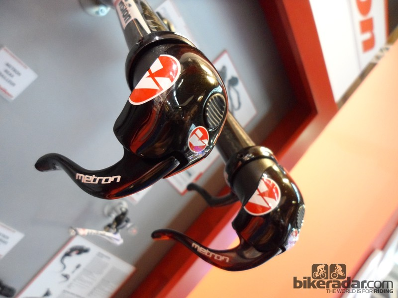 The shifter's blade handles upshifts, whereas the button on the front of the housing deals with downshifts