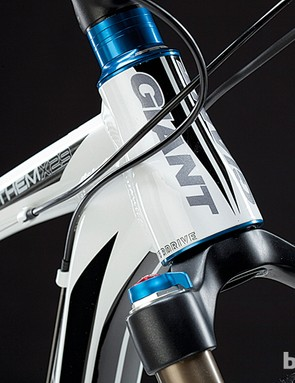 A tapered head tube, along with the chunky down tube, form an efficiently rigid backbone