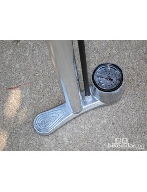 The single-footed aluminum base is sturdy but not all that stable. The large dial gage is easy to read