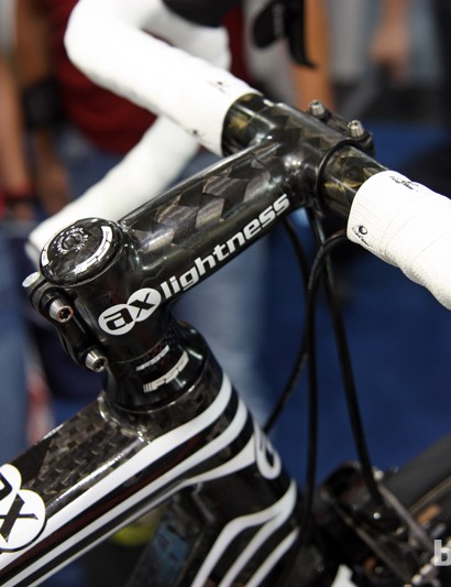 Can't get enough carbon fiber in your bicycle diet? AX-Lightness's Zeus stem supposedly weighs no more than 70g. Suggested retail price, however, is a startling 630 Euros