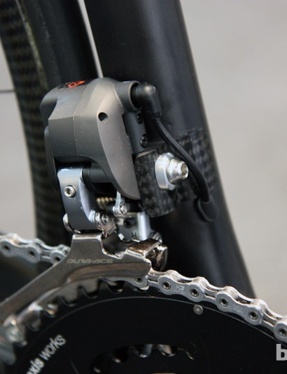 Check out the tidy carbon fiber front derailleur mount on this creation from Swedish builder Rolo