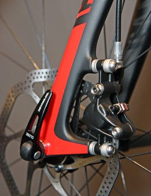 Canyon's prototype Ultimate CF SLX Disc uses carbon fiber post mount tabs for the front caliper