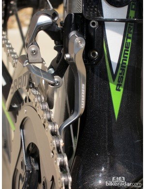 The new SRAM Red front derailleur incorporates a clever chain catcher that's easy to adjust and firmly locks in place. It can also be retrofitted to other derailleurs, too