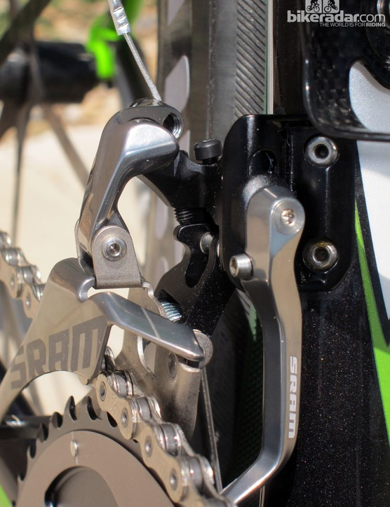 The pivots on the new SRAM Red front derailleur aren't parallel. This allows the cage to self-adjust for angle throughout the range of travel, eliminates chain rub, and does away with the need for front trim positions