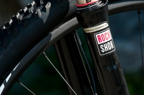 Many riders have a RockShox fork; only one has a '2011 World Champion' edition