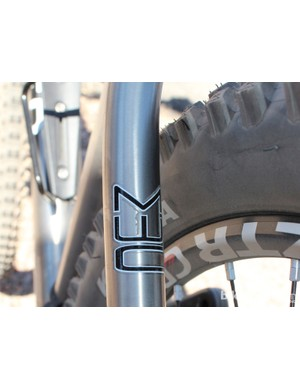 MWC stands for Multi Wheel Compatible. It means 26in and 650b wheels are possible - but not 29in ones
