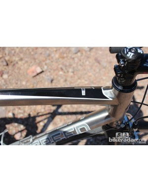 The new T1 uses a highly expensive titanium alloy with a highly expensive shaping process on the top tube