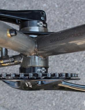 An eccentric bottom bracket tightens up the chain