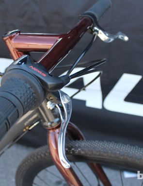 A Shimano Nexus 3-speed shifter helps with the cockpit's minimalist look