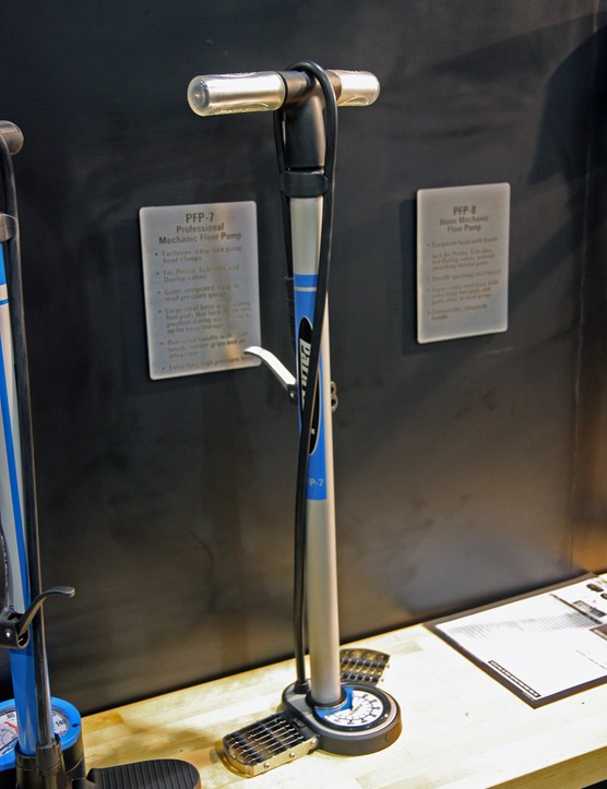 The new Park Tool PFP-7 Professional Mechanic Floor Pump sports a big, floor-mounted gauge, aggressively textured flip-up steel feet, a padded handle, and an extra-long hose