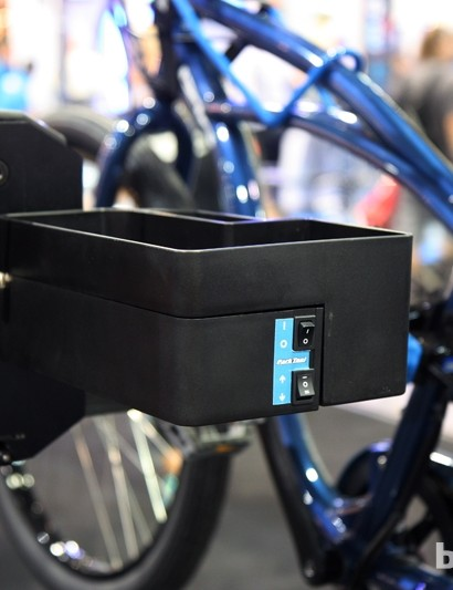 The Park Tool PRS-33 Power Lift Shop Stand is controlled by two switches mounted to the side of the tool tray