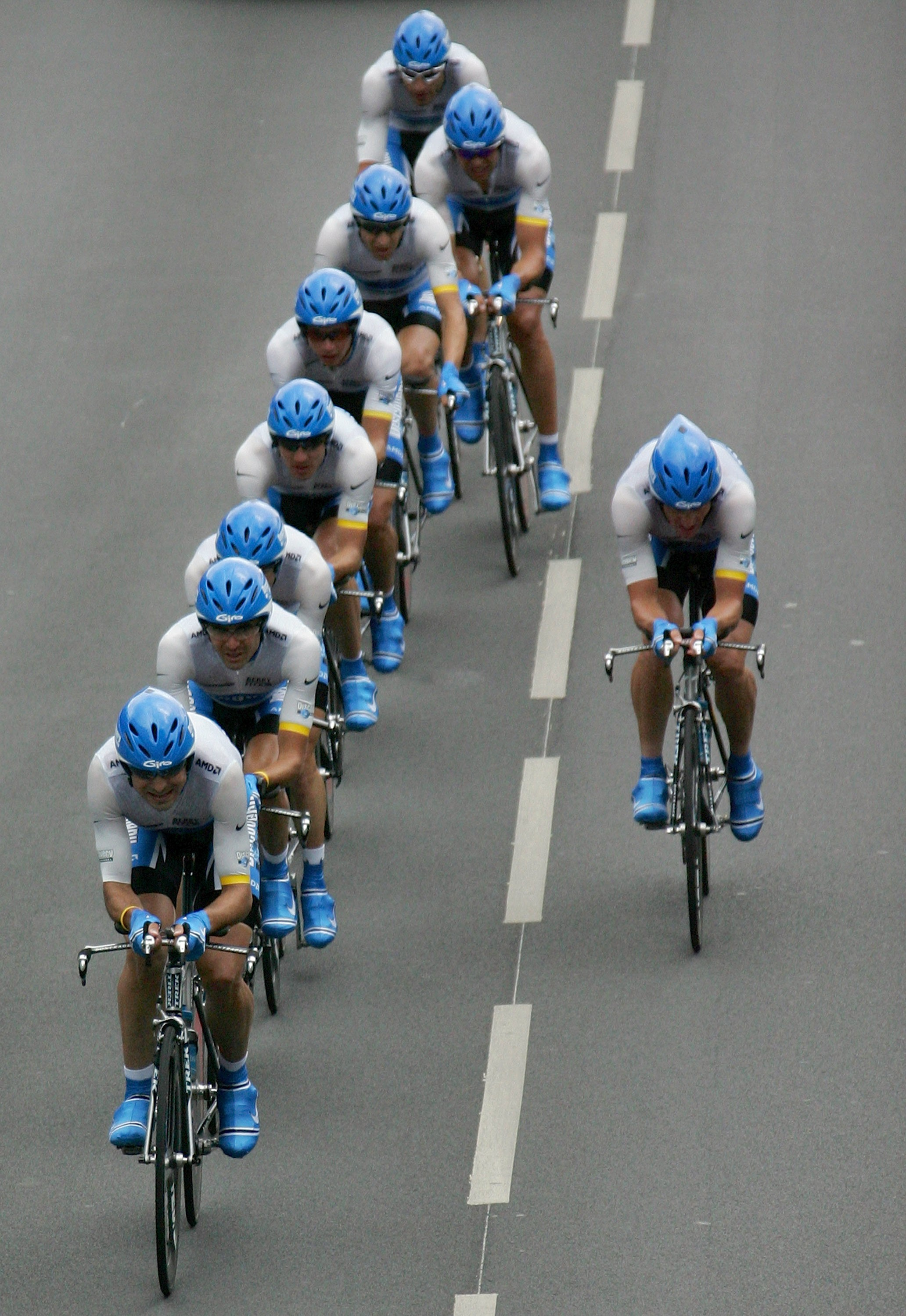 Lance Armstrong (right) drops back from the neat Discovery Channel line during the 2005 Tour de France TTT