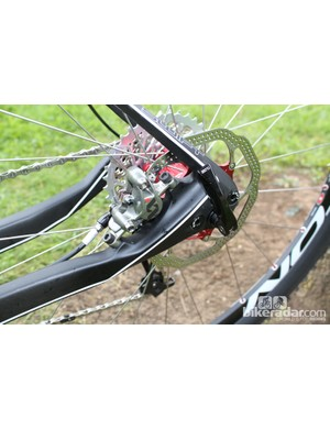 A post-mount brake sits inside the chunky chainstays, while the thinner seatposts look set to offer some comfy flex