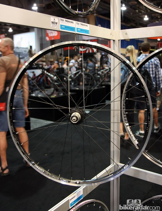 The American Classic TCX wheels are aimed at trekking and gravel road use, with tubeless compatibility and big, 26m-wide aluminum rims