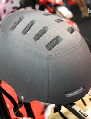 The Lazer Armor Deluxe helmet differs from the standard Armor with more upscale finishes, leather straps and metal hardware