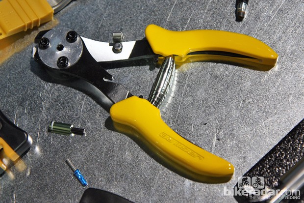 Jagwire's new Pro Cable Cutter and Crimper includes a receptable at its center that not only holds a cable end cap (so that you won't drop it on the shop floor again) but crimps it securely and evenly on three sides