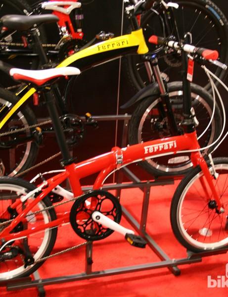 Slapping a Ferrari logo on a folding bike doesn't make it faster, only funnier