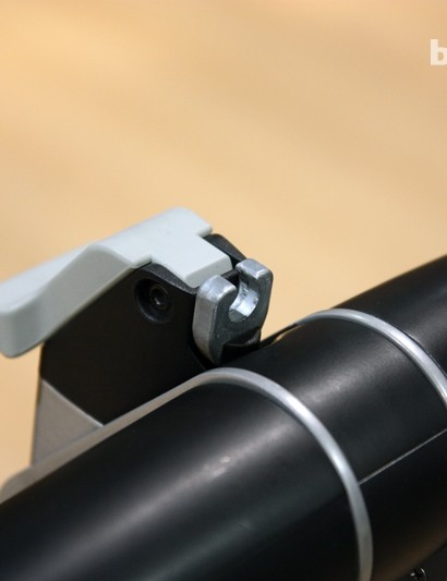 Up top on the new Thule Helium Aero is a hidden cable lock and the lever for tilting down the arms when not in use