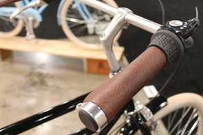 Leather grips and a leather saddle bring the style up a touch from rubber