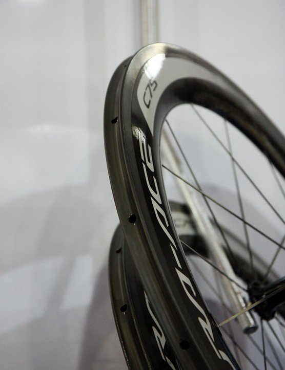 Spoke nipples are hidden inside the new, wide-profile, 75mm deep carbon fiber rim on Shimano's latest Dura-Ace WH-9000-C75-TU tubulars