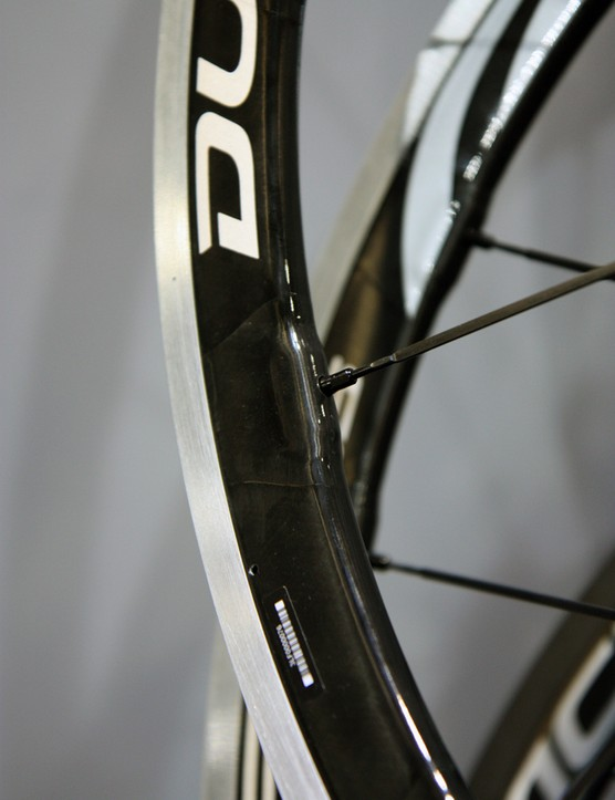 The carbon-and-aluminum clincher rims on the Shimano WH-9000-C35-CL rims feature spoke holes reinforced with extra layers of carbon fiber that are applied by hand