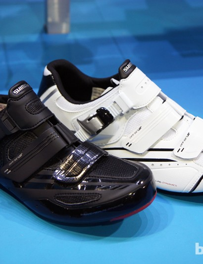 Shimano's new SH-R107 (foreground) uses a carbon fiber insert to reinforce the otherwise nylon sole. The new women's-specific SH-R088W features a similar sole but with an all-nylon outsole