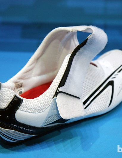 A supplemental hook-and-loop patch and a specifically placed notch hold the strap open on Shimano's new SH-TR60 triathlon shoes for faster transitions