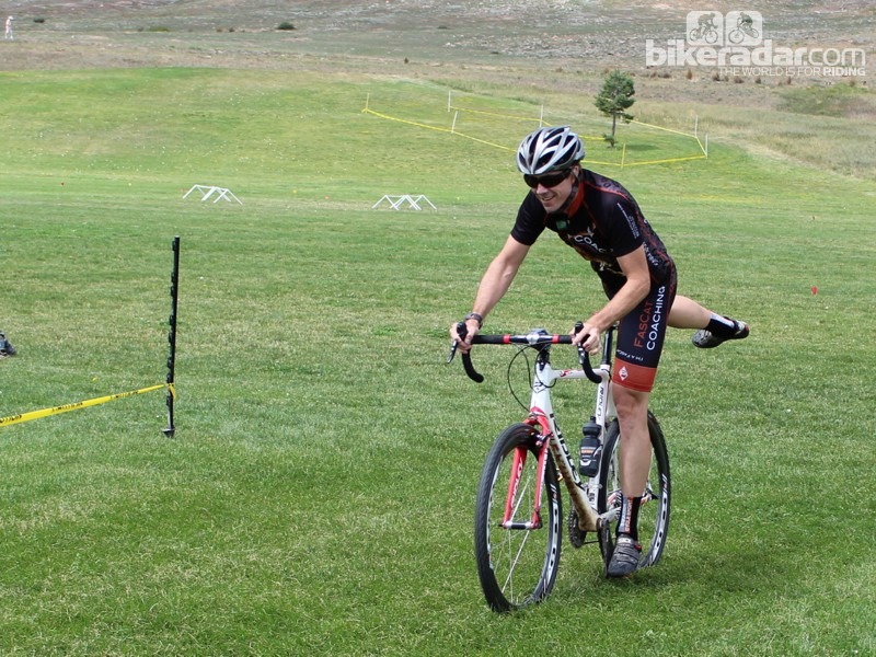 Cyclocross dismount step 1: Swing your right leg over the saddle