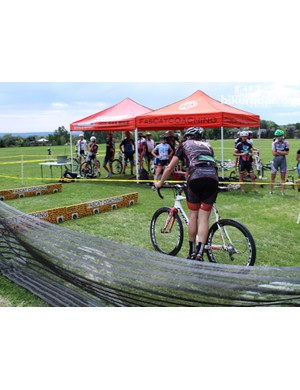 Cyclocross dismount step 6: With your weight on your arms, swing your right foot to the outside of your left foot, then unclip your left foot