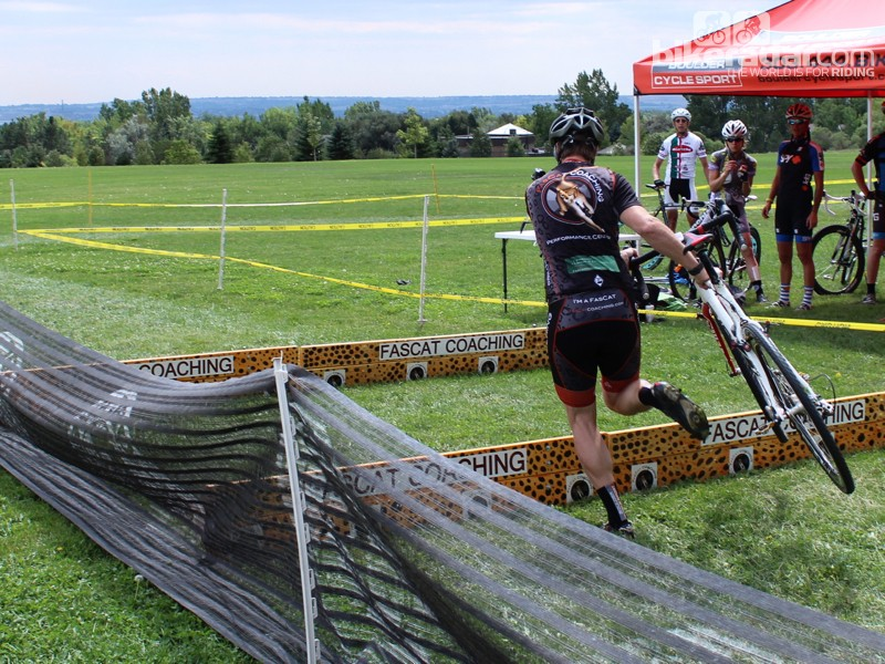 Cyclocross dismount step 8: Take one step onto your left foot, then jump the barrier