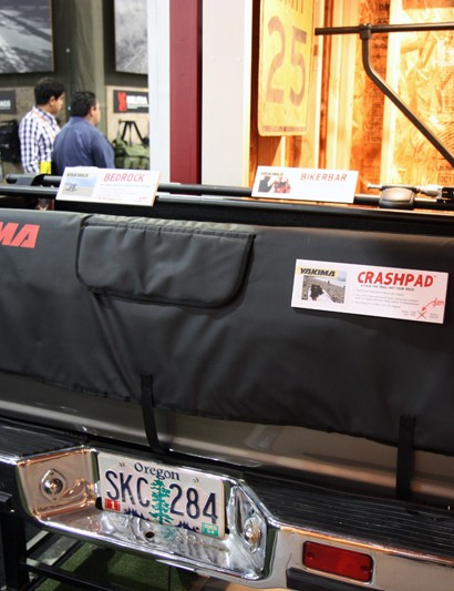 The new Yakima CrashPad is a simple tailgate pad made of high-density foam and covered with durable woven nylon. Raised bits at the edges keep the bikes from sliding into the sides of the bed and there's a flap for accessing the liftgate handle