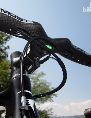 Cables are tucked away behind bolt-on covers on the Pinarello Most integrated cockpit. We'd recommend wrapping the tops with bar tape, though, as the cable covers have surprisingly sharp edges