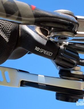 Detented cable tension adjusters are built into the end of each shifter for handy on-the-fly tweaks