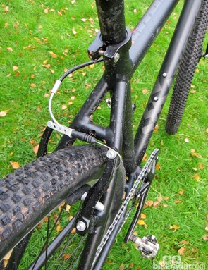 Unless you're really facing some muck, rim brakes should do fine