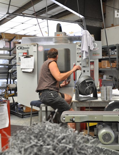 One of MRP's 19 employees operates the CNC vertical mill