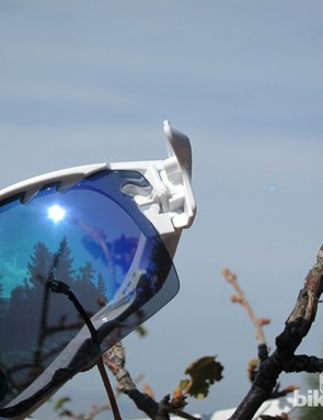 The edge of the Oakley RadarLock XL frame pivots open for simple lens swaps with minimal finger contact