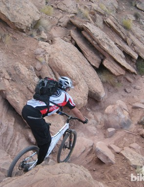 One of the many technical sections on lower Porcupine Rim, demonstrated here by pro trials rider, Akira Yasuda