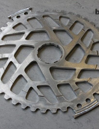 While the smaller of the 10 cogs are being machined, the aluminum 42-tooth cog is cut and then stamped.
