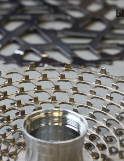 The aluminum cog is pressfit onto the steel cassette body; 16 points of contact hold it in place.