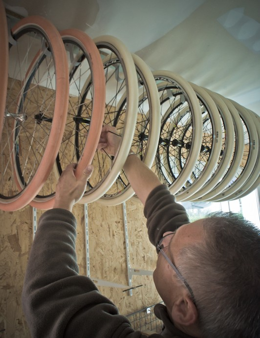 Marie hanging some cyclocross tires to dry between stages of production