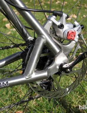The post-mount rear brake tabs are reinforced with a sturdy TIG-welded strut