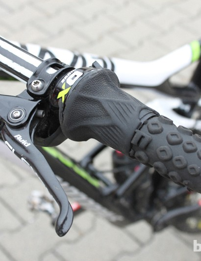 But wait, if Clementz is running a 1X11 drivetrain, then why does he have a front shifter? Clementz uses this XO Gripshifter as the remote for the Fox Dyad RT2 rear shock