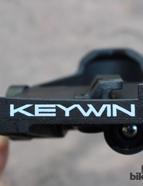 You clip out of the Keywins are you would any other regular road pedal - just pivot your foot out and the cleat pops clear