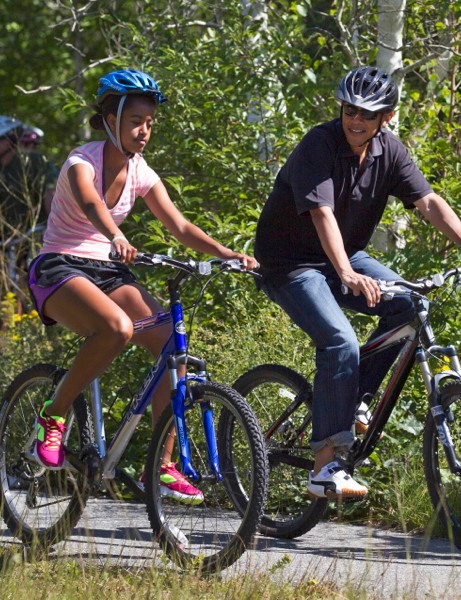 President Obama rides with his daughter Malia