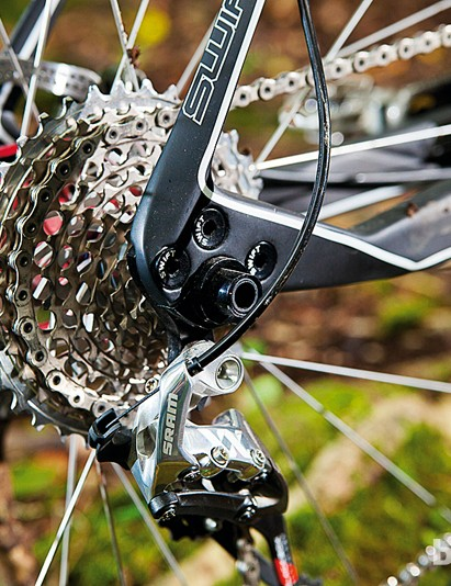 The neat-looking, integrated, replaceable mech hanger and bolt-thru axle