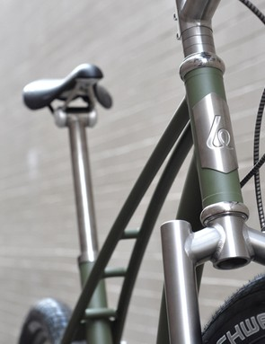 Brushed titanium parts, including the head badge, adorn the ti frame