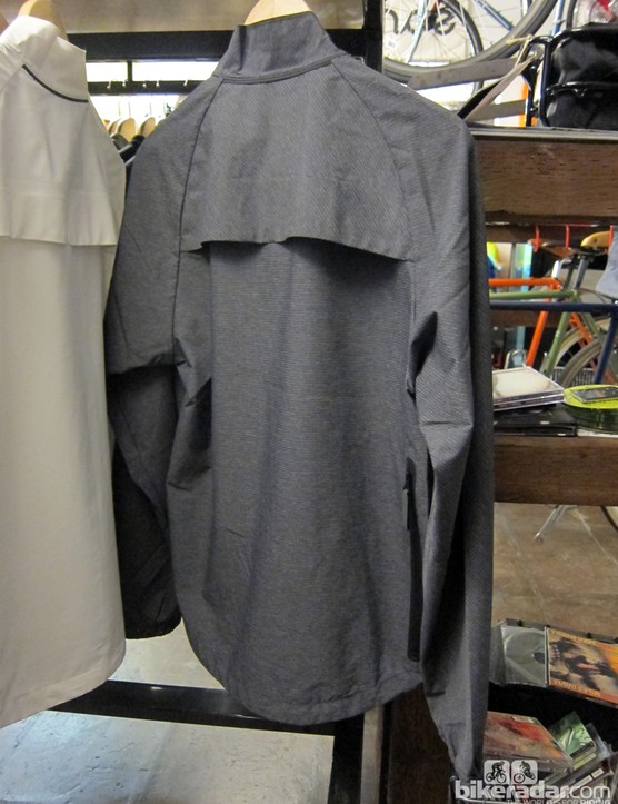 The jacket features a dropped tail and vents in the upper back