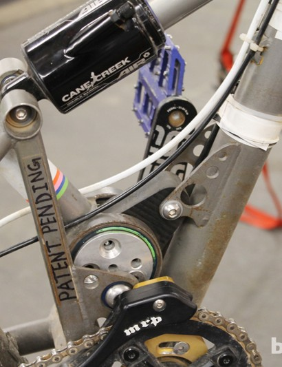 "Bicycle Fabrications eccentric disc link connected to a polyurethane elastomer spring and the main swing arm on ""Candyman"""