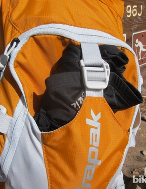 An easily accessible outer pocket holds a jacket securely with a quick-release buckle