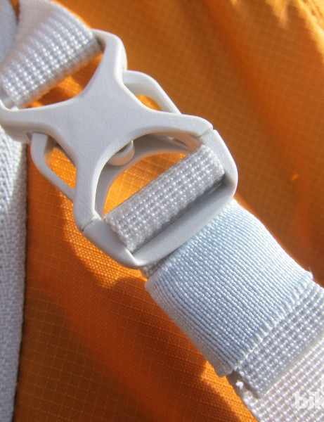 Each strap and buckle features an elastic band to house excess